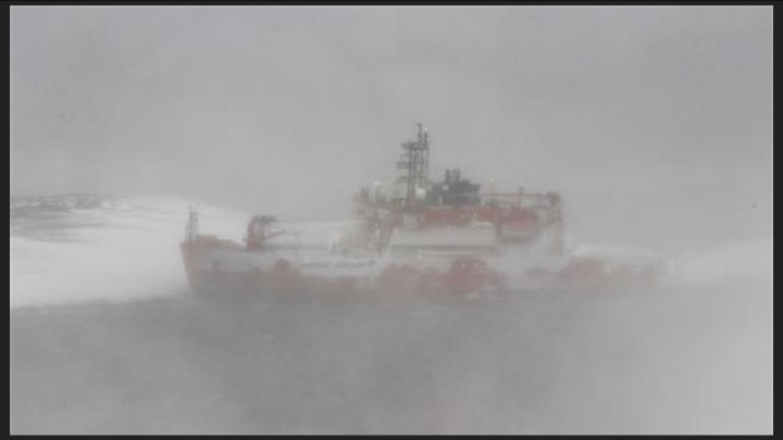 A photo taken on February 25, 2016 and received from the Australian Antarctic Division (AAD) shows Australia's flagship icebreaker Aurora Australis run aground at Mawson Station in Antarctica. (Via AFP)
