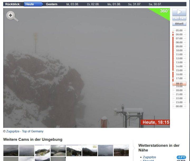 Webcambild von der Zugspitze mit Hochsommer-Neuschnee und Schneefall bei -3,0°C am 5.8.2016, 18.50 Uhr MESZ. Quelle: http://www.bergfex.de/zugspitze/webcams/c6130/